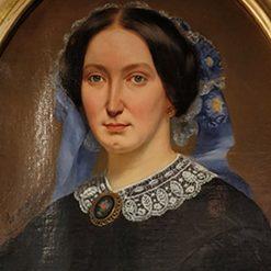 Tableau représentant une femme à la coiffe fleurie